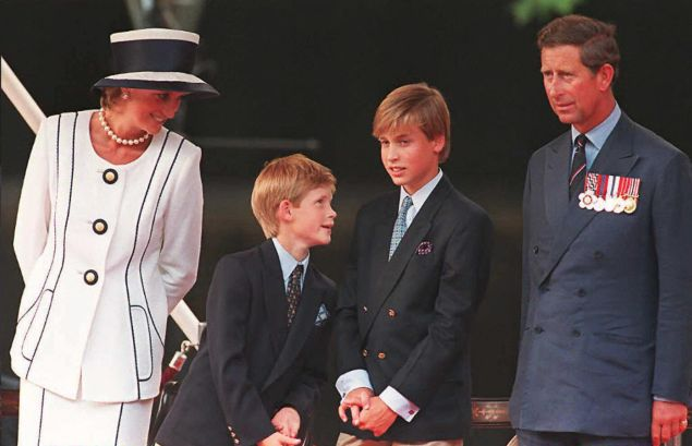 Princess Diana with Prince Harry, Prince and William(2nd R), and Prince Charles(R) watch the parade march past as part of the commemorations of VJ Day 19 August in London. The commemoration was held outside Buckingham Palace and was attended by 15,000 veterans and tens-of-thousands of spectators.