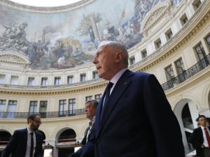 French businessman Francois Pinault tours the former stock exchange building within the presentation of the project for the future museum of the Pinault Foundation, on June 26, 2017 in Paris. A concrete cylinder inserted in a classic arcaded rotunda: Japanese architect Tadao Ando on June 26 presented his plan to transform the former stock exchange building in Les Halles district of Paris into a new museum of the Pinault Foundation whose opening is scheduled for early 2019.
