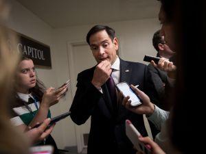 WASHINGTON, DC - JUNE 27: Sen. Marco Rubio (R-FL) speaks to reporters on his way to a closed-door Senate GOP conference meeting on Capitol Hill, June 27, 2017 in Washington, DC. The Senate GOP announced they will delay a vote on their health care bill until after the July 4 recess.