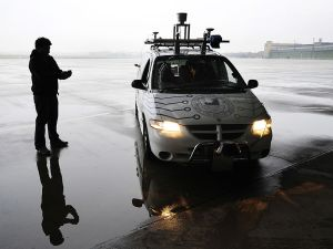 "Researcher Tinosch Ganjineh drives the ""Spirit of Berlin"", an autonomous car, with an iPhone, using a wifi connection, at Berlin's Templehof airport November 2, 2009. The Spirit of Berlin is a project of the Artificial Intelligence Group, directed by Rojas, at Berlin's Freie Universitaet. AFP PHOTO JOHN MACDOUGALL (Photo credit should read JOHN MACDOUGALL/AFP/Getty Images)"