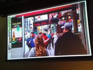 Intersection showed images of a kiosk directing pedestrians to a bar stocked with New Belgium's IPA.