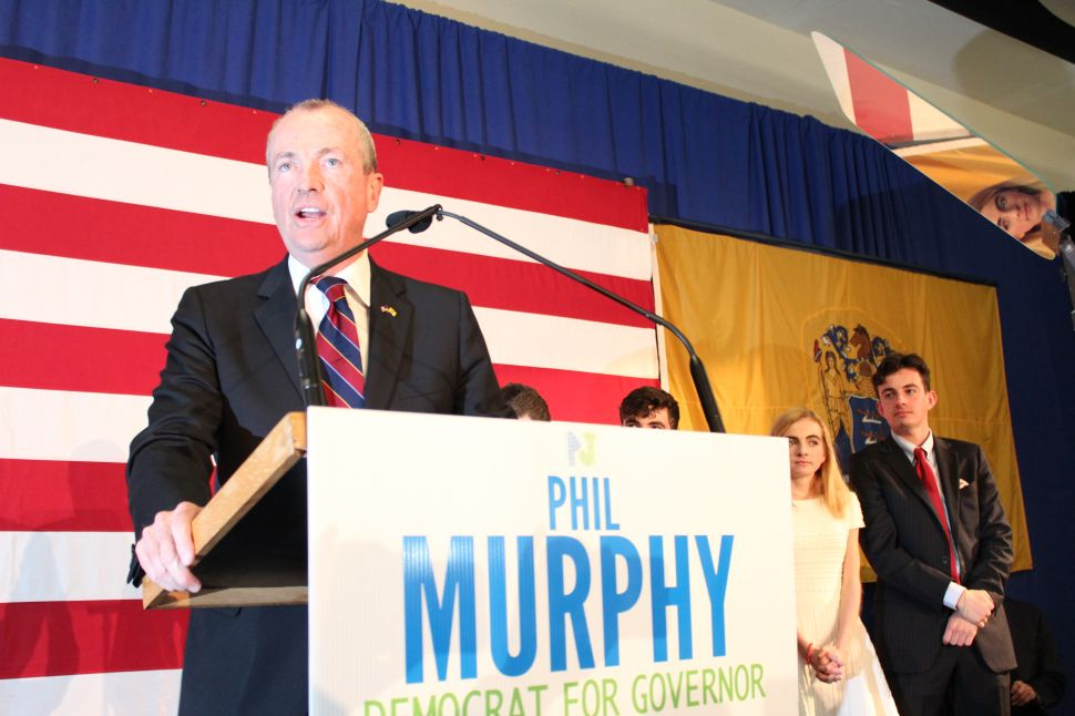 Murphy Plays Cards Close on Menendez Trial