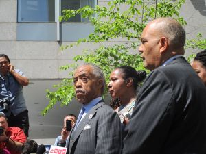 Rev. Al Sharpton with Esaw Garner and National Action Network attorney Michael Hardy.