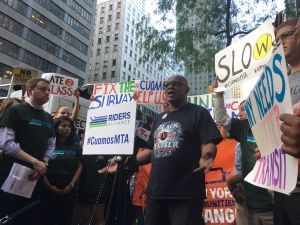 Vaughn Armour, a member of New York Communities for Change, at a rally in front of Governor Cuomo's office blasting problems with the city's subway system.