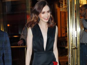 Lily Collins wears Prada to celebrate Anna Wintour.