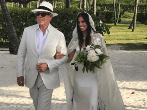Tommy Hilfiger walks his daughter, Ally, down the aisle.