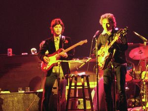 The Band performs with Bob Dylan in 1974. (Left to right: Rick Danko (bass), Robbie Robertson (guitar), Bob Dylan (guitar), Levon Helm(drums))