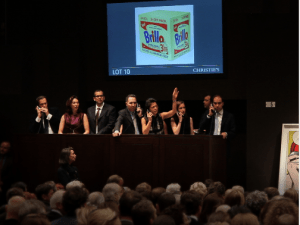 The bidding auction for Andy Warhol'sBrillo Box at Christie's.