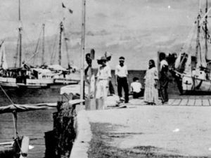 A newly rediscovered photo from the National Archives is believed to picture Amelia Earhart and be the first substantial proof that she survived crashing in the Pacific.