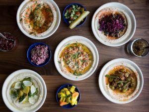 Selection of five hummus with rotating seasonal toppings
