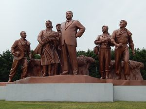 A statue of Kim Il-sung and farmers at a collective farm south of Pyongyang.