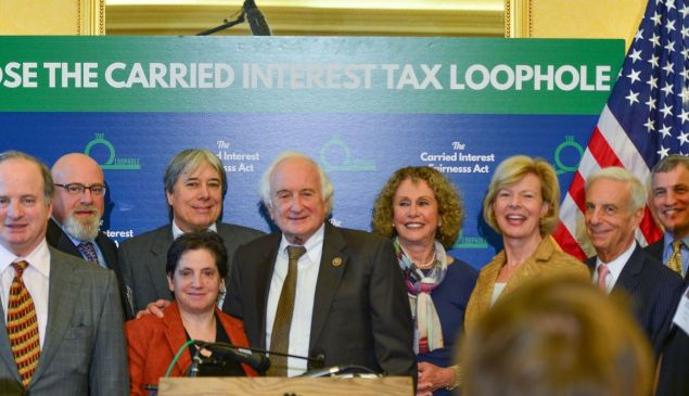 Members of Patriotic Millionaires, whose privileged members advocate for higher taxes on the rich, met with lawmakers in this 2015 photo to discuss legislation to close the carried interest loophole.