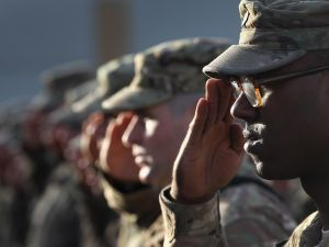 U.S. Army soldiers salute during the national anthem.
