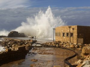 Waves smash into breakers protecting the Roman-era port of Caesarea on December 13, 2010 after a massive storm battering the eastern Mediterranean destroyed the breakers threatening to wash away the historic site, Israeli officials said.