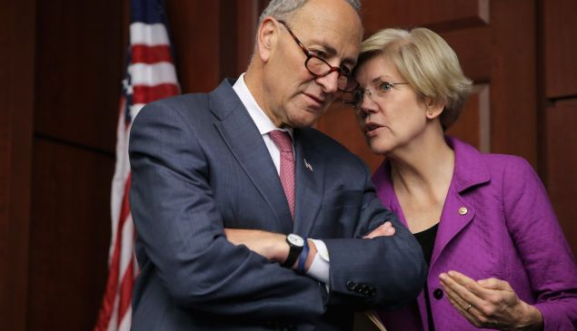 Sen. Charles Schumer (D-NY) (L) and Sen. Elizabeth Warren (D-MA) talk during a news conference on the fifth anniversary of the Dodd-Frank Wall Street Reform and Consumer Protection Act at the U.S. Capitol.