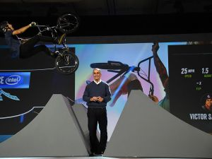 LAS VEGAS, NV - JANUARY 05: BMX rider Victor Salazar jumps over Intel Corp. CEO Brian Krzanich on a bike fitted with Intel Curie chips in the handlebars and seat during Krzanich's keynote address at CES 2016 at The Venetian Las Vegas on January 5, 2016 in Las Vegas, Nevada. Sensors recording the jump displayed data on a screen in real time to demonstrate how the technology can be used for sports television coverage. CES, the world's largest annual consumer technology trade show, runs from January 6-9 and is expected to feature 3,600 exhibitors showing off their latest products and services to more than 150,000 attendees. (Photo by Ethan Miller/Getty Images)