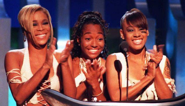 "Tionne ""T-Boz"" Watkins, Rozonda ""Chilli"" Thomas and Lisa ""Left Eye"" Lopes of the group TLC at the 1995 MTV Video Music Awards."