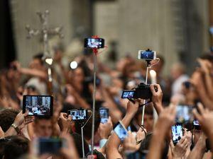 Selfie sticks in church? Have you no shame?