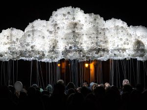 "People take part to an interactive art installation ""Cloud"" created from 6,000 lightbulbs by Canadian artists Caitlind RC Brown & Wayne Garrett, during ""The White Night"", a night-time art festival in Bratislava, Slovakia on October 08, 2016. / AFP / VLADIMIR SIMICEK (Photo credit should read VLADIMIR SIMICEK/AFP/Getty Images)"