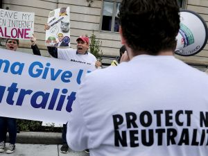 Supporters of net neutrality protest FCC director Ajit V. Pai outside the American Enterprise Institute