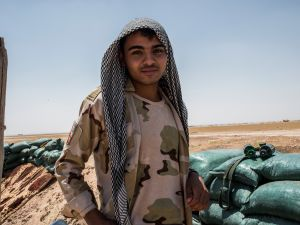 An Iraqi PMF fighter June 20, 2017 on the Iraq-Syria border in Nineveh, Iraq. The PMF have pushed Islamic State militants from the north-western Iraq border strip back into Syria.