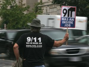 A protestor holds a sign claiming the 11 September 2001 attacks on the US were an inside job near the White House in September 2007.