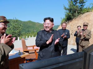 Kim Jong-un and scientists applaud after the successful test of intercontinental ballistic missile Hwasong-14.