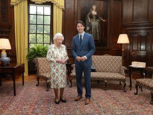 Queen Elizabeth II greets Canadian Prime Minister Justin Trudeau.