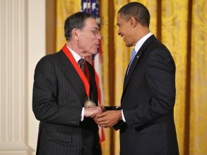 US President Barack Obama shakes hands with former director of the Metropolitan Museum of Art Philippe de Montebello after presenting him with the 2009 National Humanities Medal during a ceremony February 25, 2010 in the East Room of the White House in Washington, DC.
