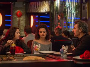 Abby Quinn as Ali, Jenny Slate as Dana, and John Turturro as their father in Landline.