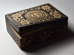 Wooden box crafted in Auschwitz by Polish prisoner Bronisław Czech, collection from the Auschwitz-Birkenau State Museum.