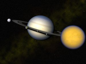 A rendering of Saturn and its moons, with Titan in the foreground.