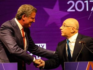 Mayor Bill de Blasio, left, and former City Councilman Sal Albanese, right, at the first mayoral Democratic primary debate.