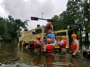 Texas National Guard members rescuing flooded Texans.