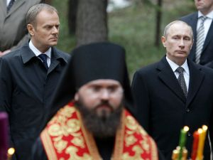 Russian Prime Minister Vladimir Putin and Poland's Prime Minister Donald Tusk attend the wreath laying ceremony at the the memorial museum to Katyn massacre on April 7, 2010.