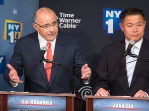 NEW YORK, NY - AUGUST 21: Democratic primary candidate for Mayor of New York City Sal F. Albanese speaks during the first debate at the Town Hall as John C. Liu listens on August 21, 2013 in New York City. Residents go to the polls September 10 for the primary election. (Photo by )