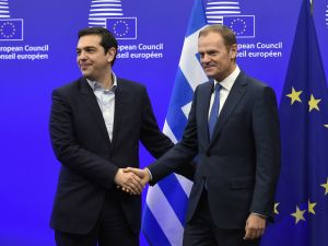 European Union President Donald Tusk (R) shakes hands with Greek Prime Minister Alexis Tsipras.