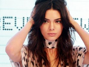 SYDNEY, AUSTRALIA - NOVEMBER 17: Kendall Jenner adjusts her hair on stage at Westfield Parramatta on November 17, 2015 in Sydney, Australia. (Photo by Lisa Maree Williams/Getty Images)