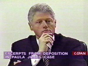 This 10 December image taken from C-Span television shows US President Bill Clinton giving videotaped sworn deposition in tha Paula Jones sexual discrimination suit. The tape was played during impeachment hearings conducted by the US House Judiciary Committee on Capitol Hill 10 December in Washington, DC.