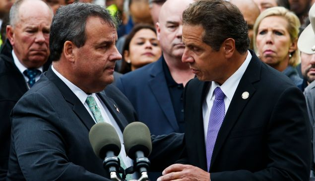NEW YORK, NY - SEPTEMBER 29: New Jersey Governor Chris Christie, (L) and New York Governor Andrew Cuomo comfort each other at the end of a press conference after a NJ Transit train crashed in to the platform at Hoboken Terminal September 29, 2016 in Hoboken, New Jersey. According to reports, at least one person has been killed and over 100 injured.