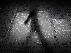 An employee walking behind a glass wall with machine coding symbols at the headquarters of Internet security giant Kaspersky in Moscow.