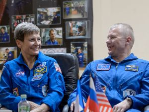 Astronauts Peggy Whitson of NASA, Russian cosmonaut Oleg Novitskiy of Roscosmos and ESA astronaut Thomas Pesquet are seen in quarantine behind glass during a crew press conference November 16, 2016.