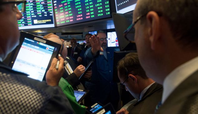 Not so wise after all? Traders work the floor of the New York Stock Exchange.