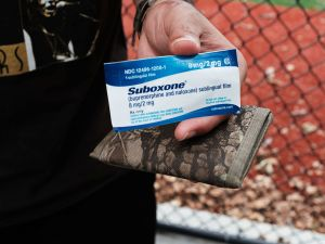 A heroin user holds suboxone near where John Jay College of Criminal Justice students are interviewing heroin users as part of a project to interview Bronx drug users in order to compile data about overdoses on August 8, 2017.