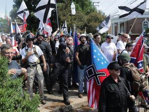 """Hundreds of white nationalists, neo-Nazis, KKK and members of the """"alt-right"""" hurl water bottles at counter demonstrators during the Unite the Right rally in August 12, 2017 in Charlottesville, Va."""