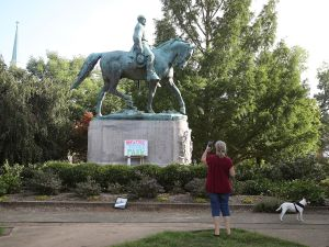 A homemade sign that says Heather Heyer Park rests at the base of the statue of Confederate Gen. Robert E. Lee that stands in the center of Emancipation Park in Charlottesville, Va. Heather Heyer was killed during a protest by white nationalists, neo-Nazis, the Ku Klux Klan and members of the 'alt-right.'