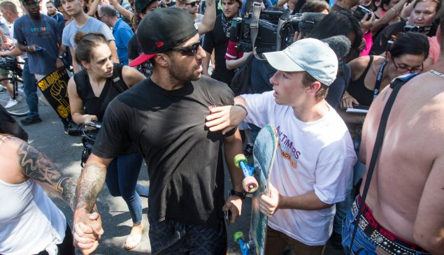 A counter protester argues with a man after a march to the 'Free Speech Rally' on Boston Common on August 19, 2017 in Boston, Massachusetts.