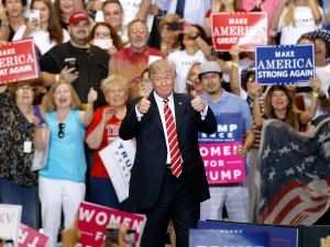 President Donald Trump gives a thumbs up to a crowd of supporters at the Phoenix Convention Center during a rally on August 22, 2017 in Phoenix, Arizona.