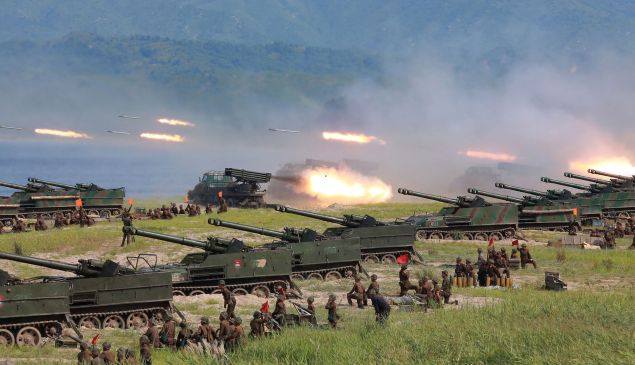 This undated photo released by North Korea's official Korean Central News Agency (KCNA) on August 26, 2017 shows rockets being launched by Korean People's Army (KPA) personnel during a target strike exercise at an undisclosed location in North Korea.