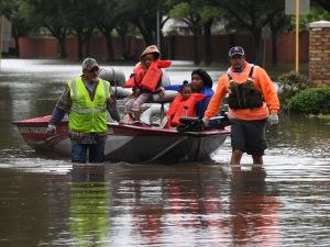 Residents evacuate after heavy flooding in Houston during Hurricane Harvey.